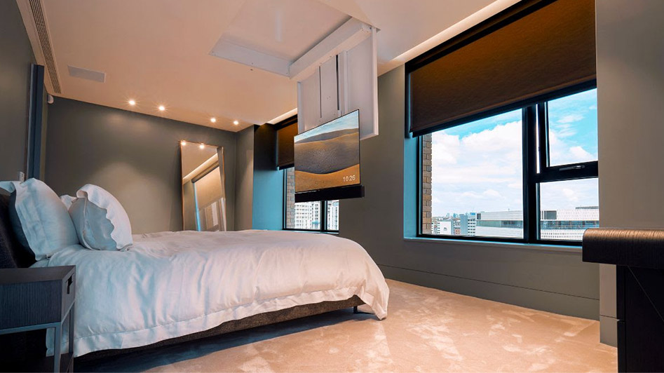 TV installed in ceiling at end of bed; tv installations