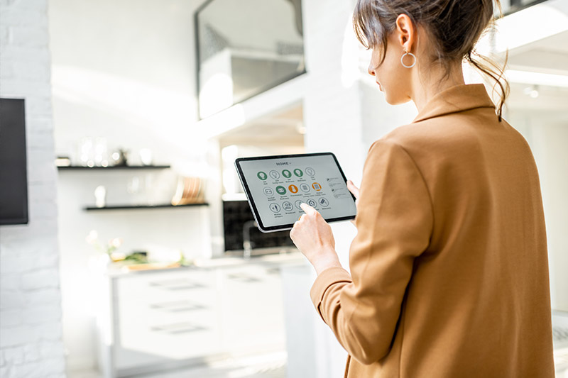 smart home tech trends woman with ipad